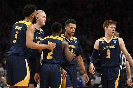 Mar 22, 2019; San Jose, CA, USA; UC Irvine Anteaters guard Evan Leonard (14) is greeted by guard Max Hazzard (2) as forward Jonathan Galloway (5) and guard Robert Cartwright (3) look on during the second half in the first round of the 2019 NCAA Tournament against the Kansas State Wildcats at SAP Center. Mandatory Credit: Kelley L Cox-USA TODAY Sports