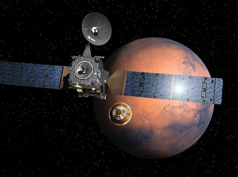 An artist's impression depicts the separation of the ExoMars 2016 entry, descent and landing demonstrator module 'Schiaparelli' from the Trace Gas Orbiter (TGO), heading for Mars (AFP Photo/D. Ducros)