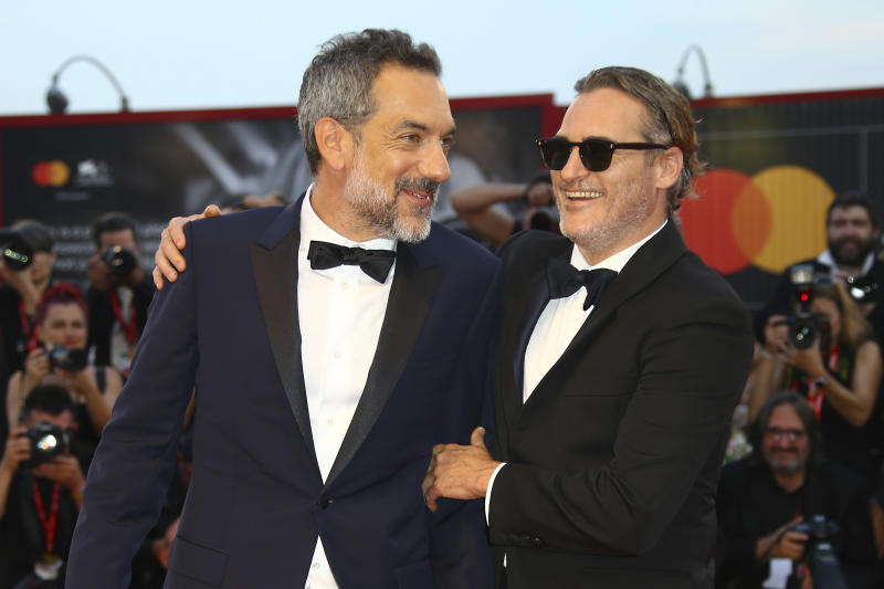 Actor Joaquin Phoenix, right, greets director Todd Phillips as they arrive at the premiere of the film 'Joker' at the 76th edition of the Venice Film Festival, Venice, Italy, Saturday, Aug. 31, 2019. (Photo by Joel C Ryan/Invision/AP)