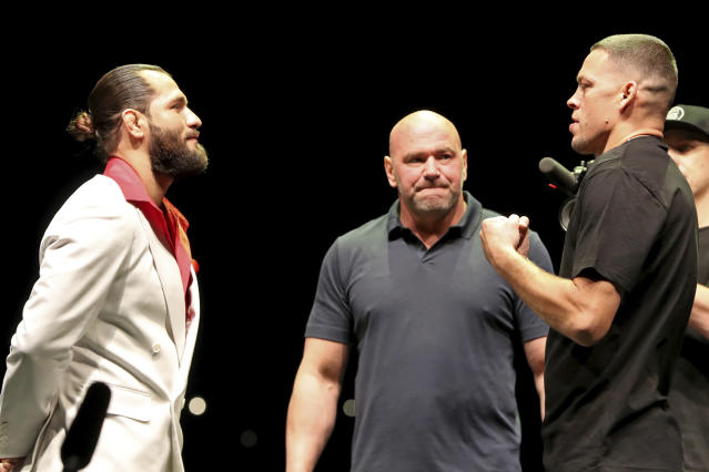 FILE - In this Sept. 19, 2019, file photo, Jorge Masvidal, left, squares off with Nate Diaz as UFC President Dana White looks on at a news conference for the UFC 244 mixed martial arts event in New York. Diaz or Masvidal will step out of the Garden on Saturday, Nov. 2, the undisputed champ of UFC 244's crudest named title _ the Baddest Mother (censored!) in the game. (AP Photo/Gregory Payan, File)