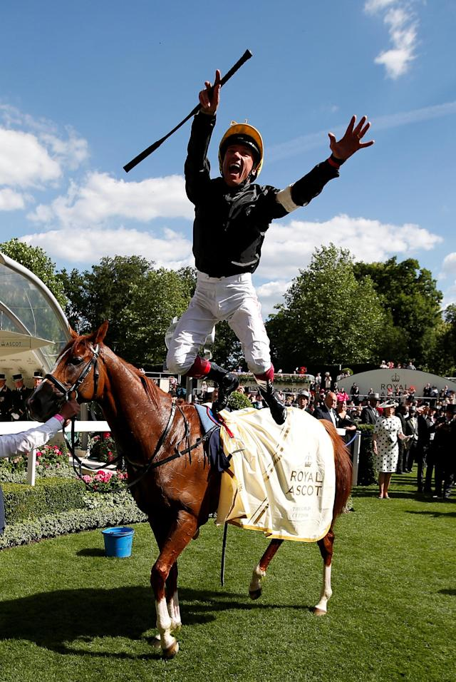 Horse Racing - Royal Ascot - Ascot Racecourse, Ascot, Britain - June 21, 2018 Frankie Dettori jumps off Stradivarius as he celebrates winning the 4.20 Gold Cup Action Images via Reuters/Paul Childs TPX IMAGES OF THE DAY