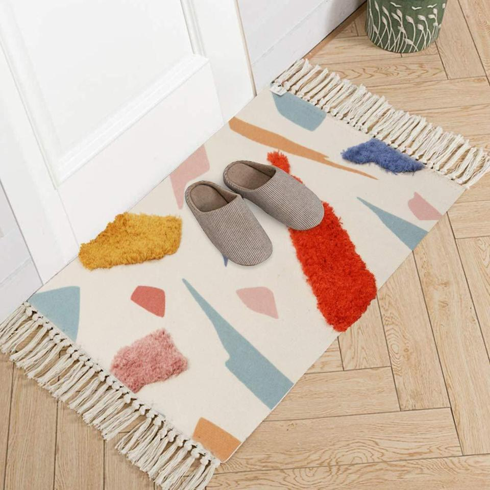 "<h2>LIVEBOX Hand-Woven Tufted Rug</h2><br>If you dig deep enough you'll find a treasure trove of expensive-looking artsy rugs on Amazon. This bright rug is great for decoration but will also protect your floor with its durable cotton fabric. <br><br><em>Shop</em> <strong><em><a href=""https://amzn.to/3dUlPgD"" rel=""nofollow noopener"" target=""_blank"" data-ylk=""slk:LIVEBOX"" class=""link rapid-noclick-resp"">LIVEBOX</a></em></strong><br><br><strong>LIVEBOX</strong> Hand Woven Tufted Tassel Throw Rug, $, available at <a href=""https://amzn.to/3fLjjLU"" rel=""nofollow noopener"" target=""_blank"" data-ylk=""slk:Amazon"" class=""link rapid-noclick-resp"">Amazon</a>"