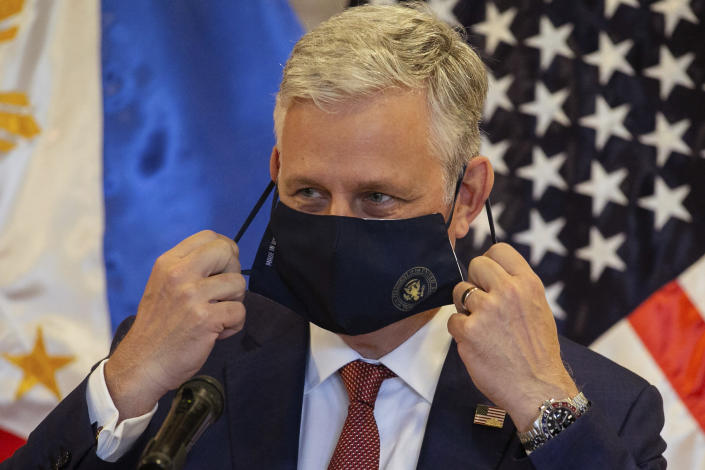 U.S. National Security Advisor Robert O'Brien removes his mask for protection against the coronavirus before speaking at the Department of Foreign Affairs in Pasay City, Philippines Monday, Nov. 23, 2020. (Eloisa Lopez/Pool Photo via AP)