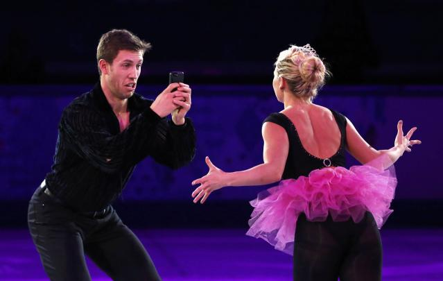 Canada's Kirsten Moore-Towers and Dylan Moscovitch perform during the Figure Skating Gala Exhibition at the 2014 Sochi Winter Olympics February 22, 2014. REUTERS/Lucy Nicholson (RUSSIA - Tags: SPORT FIGURE SKATING OLYMPICS TPX IMAGES OF THE DAY)
