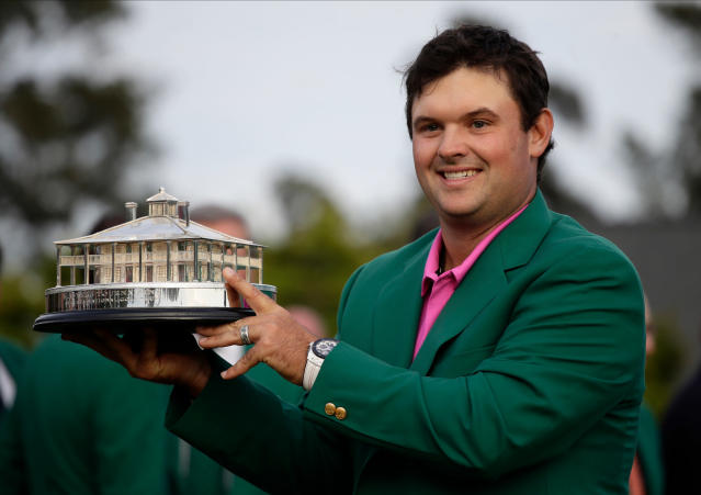Patrick Reed holds the championship trophy after winning the Masters golf tournament Sunday, April 8, 2018, in Augusta, Ga. (AP)