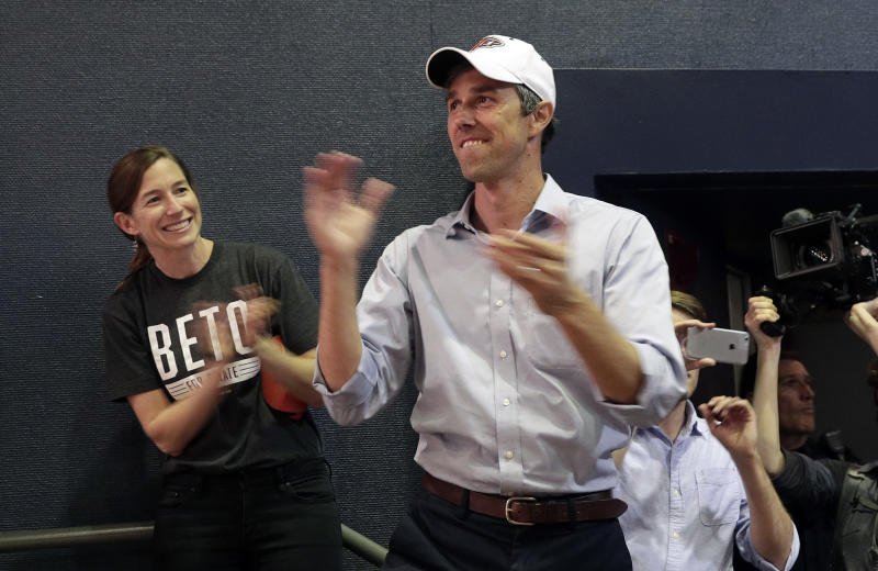 FILE - In this Nov. 5, 2018 file photo, then Rep. Beto O'Rourke, D-El Paso, with his wife Amy, left, arrives for a campaign rally in El Paso, Texas. Democratic presidential candidate Beto O'Rourke's father-in-law, William Sanders, is worth at least $500 million and has helped make the former Texas congressman and his wife millionaires. He donated to O'Rourke's bids for El Paso City Council, Congress, Senate and president. O'Rourke's campaign says Sanders plays absolutely no role. Still, O'Rourke, who is known as a champion of little-guy values, might never have made it on the national stage without the help of the intensely private tycoon. (AP Photo/Eric Gay)