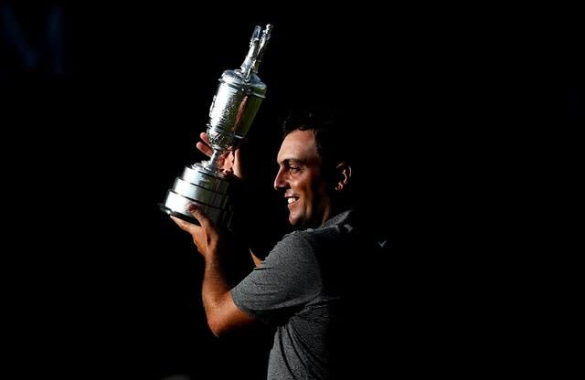 Italy's Francesco Molinari lifts The Open's Claret Jug after winning at Carnoustie in 2018. Molinari played a key role in Europe's Ryder Cup win later that year, becoming the first player to win five matches. He partnered Tommy Fleetwood in the fourballs and foursomes. He also won the European Tour's Race to Dubai title (David Davies/PA)