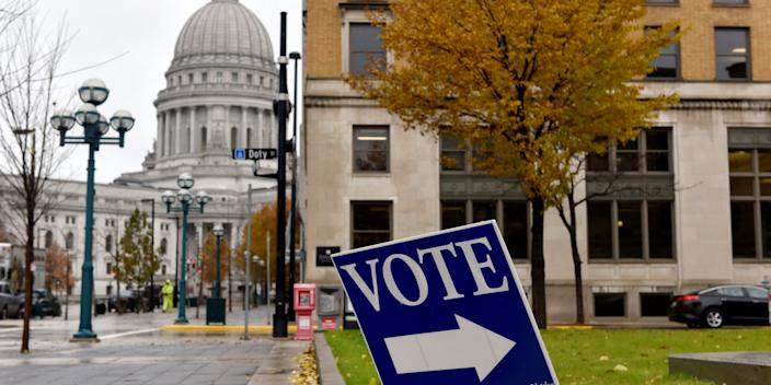 "In this 2018 file photo, a sign directs voters towards a polling place near the state capitol in Madison, Wisconsin. <p class=""copyright"">Reuters</p>"