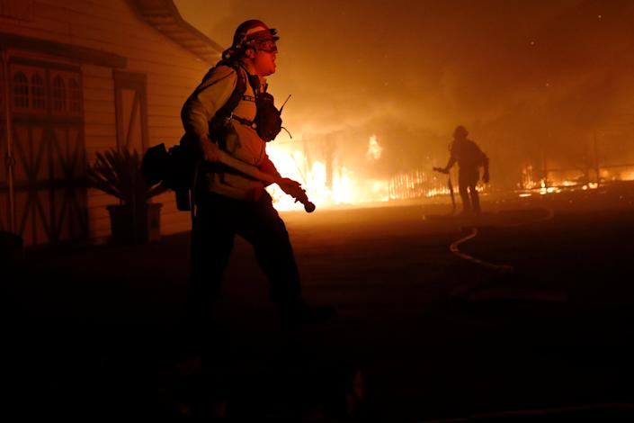 A firefighter gives orders as he battles the wind-driven Kincade Fire in Windsor, California, Oct. 27, 2019. (Photo: Stephen Lam/Reuters)