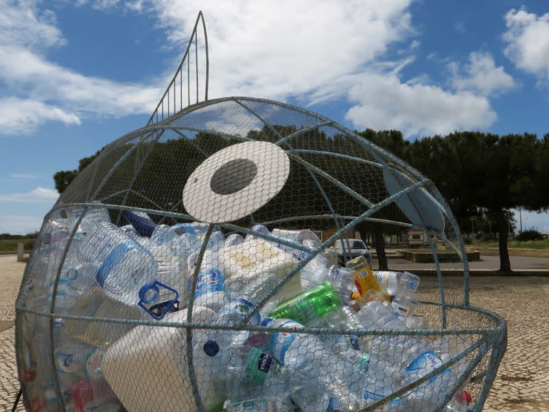 FILE PHOTO: Collected plastic bottles or PET bottles are seen inside a fish-shaped container on the port in Alvor
