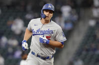 Los Angeles Dodgers' Corey Seager rounds the bases after hitting a two-run home run during the third inning of a baseball game against the Seattle Mariners, Monday, April 19, 2021, in Seattle. (AP Photo/Ted S. Warren)