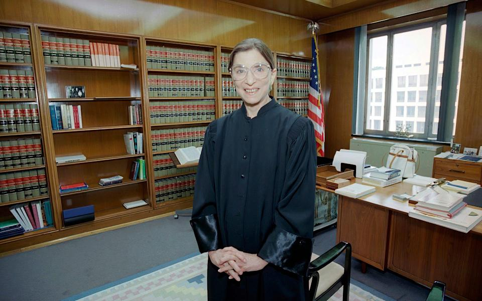 In this Aug. 3, 1993, file photo, then-Judge Ruth Bader Ginsburg poses in her robe in her office at U.S. District Court in Washington. Earlier, the Senate voted 96-3 to confirm Bader as the 107th justice and the second woman to serve on the Supreme Court - Doug Mills/AP