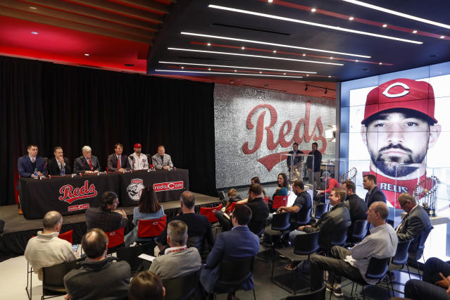 Cincinnati Reds' Nick Castellanos at table second from right, sits for questions from reporters during a news conference, Tuesday, Jan. 28, 2020, in Cincinnati. Castellanos signed a $64 million, four-year deal with the baseball club. (AP Photo/John Minchillo)