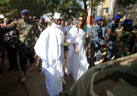 Gambian President Jammeh arrives at a polling station with his wife Zineb during the presidential election in Banjul