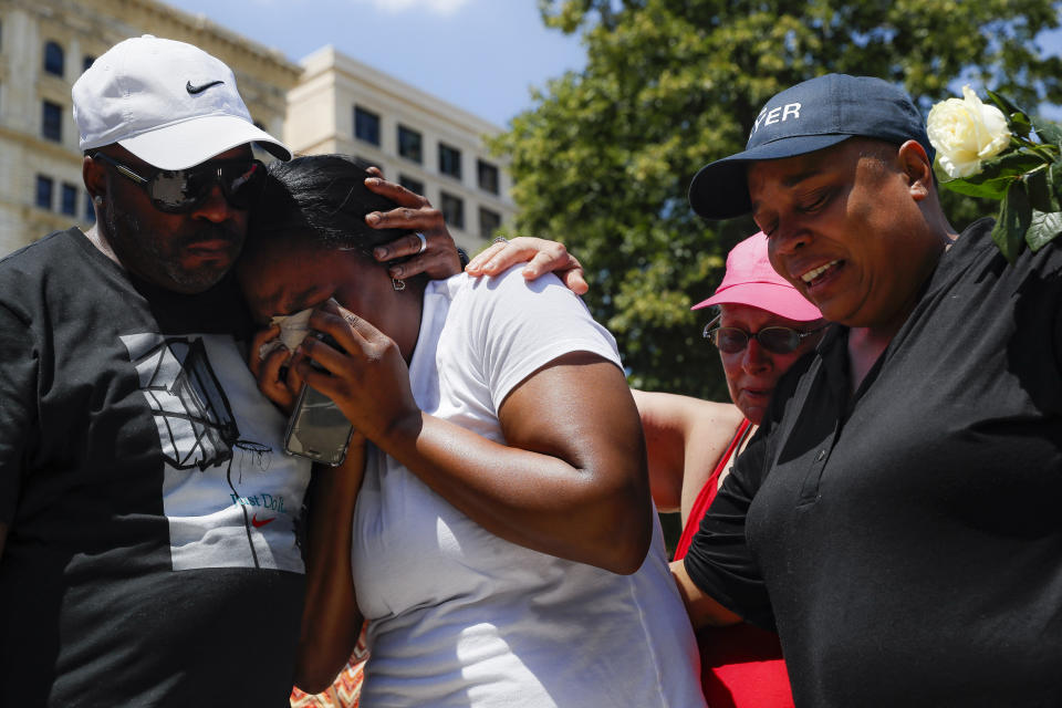 Mourners gather at a vigil following a mass shooting in Dayton, Ohio, on Sunday. (AP Photo/John Minchillo)