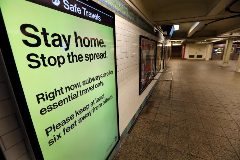 FILE PHOTO: A message is seen on an electronic display inside a mostly empty 42nd Street subway station during the coronavirus outbreak in New York
