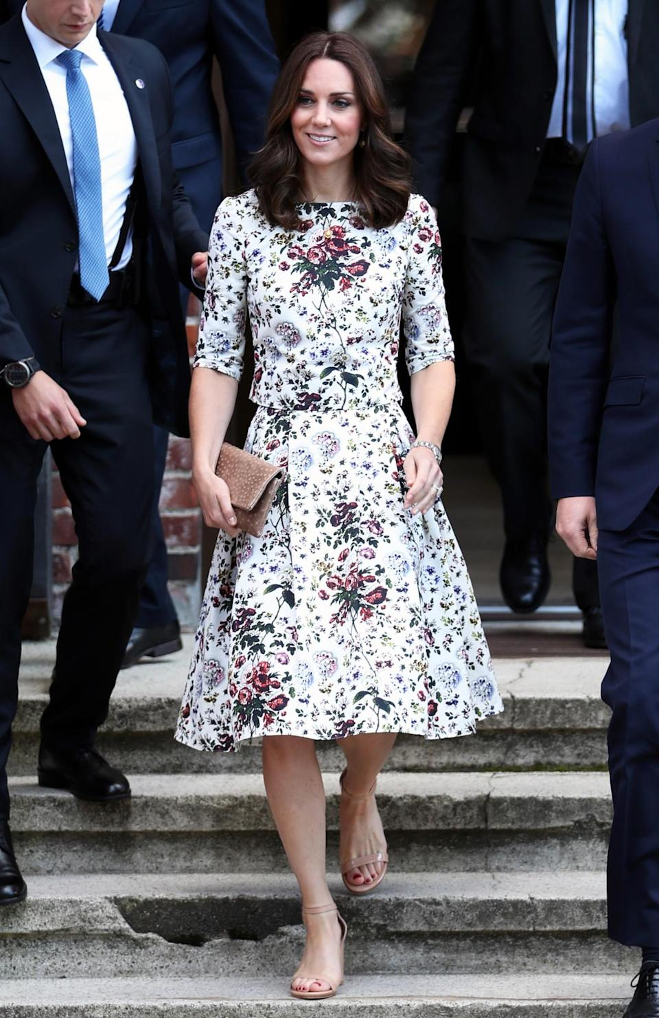 <p><b>For a sombre visit to a concentration camp, Kate dressed conservatively in a floral, midi dress by London Fashion Week designer Erdem. <br><em>[Photo: PA]</em> </b></p>