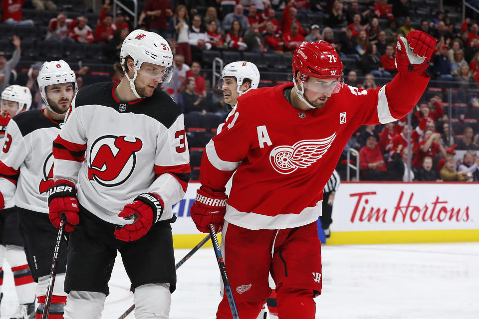 Detroit Red Wings center Dylan Larkin (71) celebrates his goal against the New Jersey Devils during the second period of an NHL hockey game Friday, March 29, 2019, in Detroit. (AP Photo/Paul Sancya)