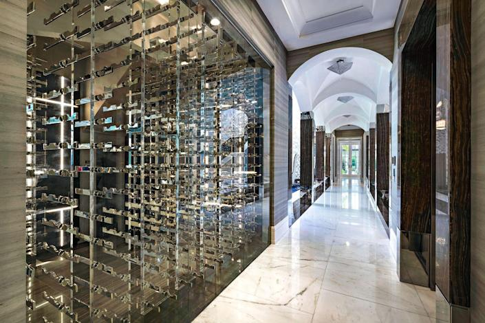 Hosting a wine night? Look no further than the glass-encased, temperature-controlled wine room.