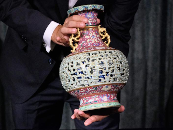 Nicolas Chow, chairman of Sotheby's Asia, holding the Harry Garner Reticulated Vase.