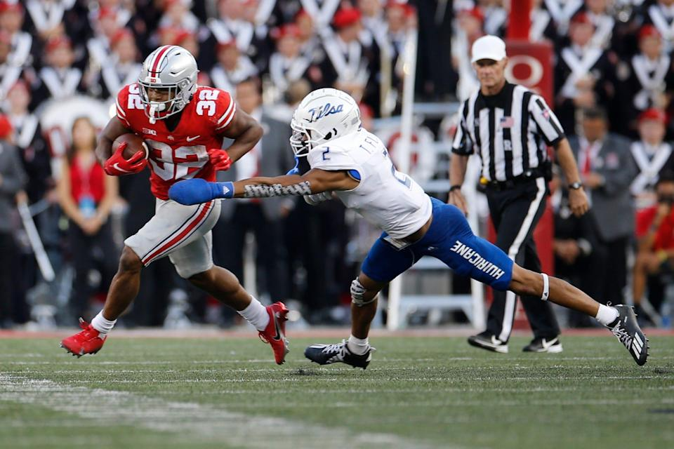 Ohio State running back TreVeyon Henderson, left, cuts upfield against Tulsa defensive back Travon Fuller during the second half of an NCAA college football game Saturday, Sept. 18, 2021, in Columbus, Ohio. (AP Photo/Jay LaPrete)