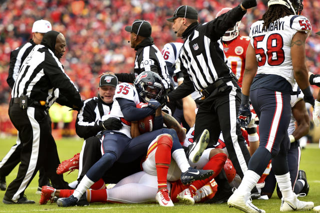 Houston Texans cornerback Keion Crossen (35) recovers the ball fumbled on a punt ball by Kansas City Chiefs wide receiver Tyreek Hill during the first half of an NFL divisional playoff football game, in Kansas City, Mo., Sunday, Jan. 12, 2020. (AP Photo/Ed Zurga)