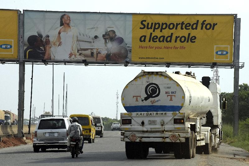 Motorists drive past a MTN billboard across the Lagos-Ibadan expressway (AFP Photo/Pius Utomi Ekpei)