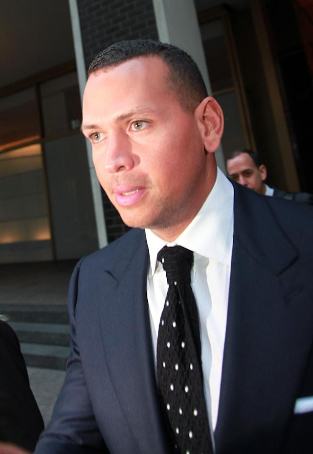 Alex Rodriguez leaves the offices of Major League Baseball in New York, where he argued why his 211-game suspension should be overturned, Monday, Sept. 30, 2013. (AP Photo/David Karp)