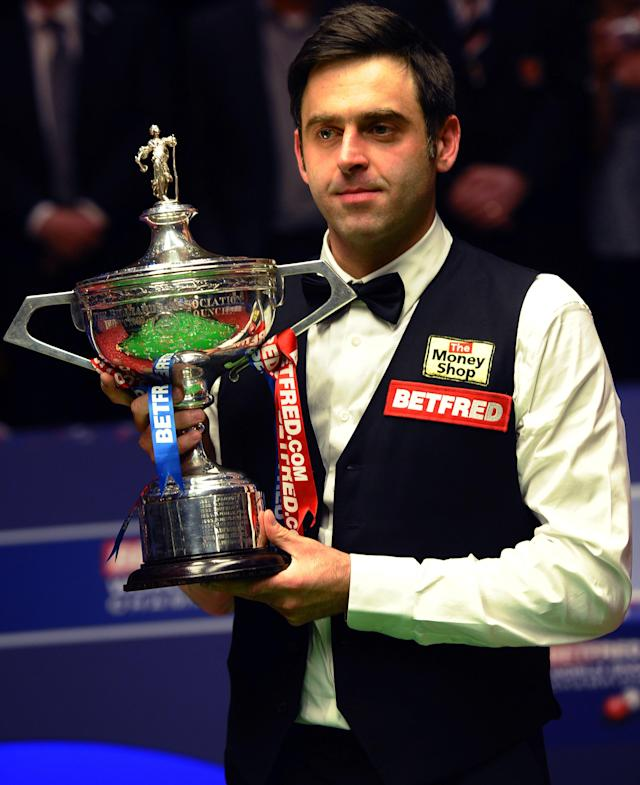Ronnie O'Sullivan celebrates on May 7, 2012 with the trophy after beating Ali Carter of England 18-11 in the World Championship Snooker final at the Crucible Theater in Sheffield, England. AFP PHOTO/PAUL ELLISPAUL ELLIS/AFP/GettyImages
