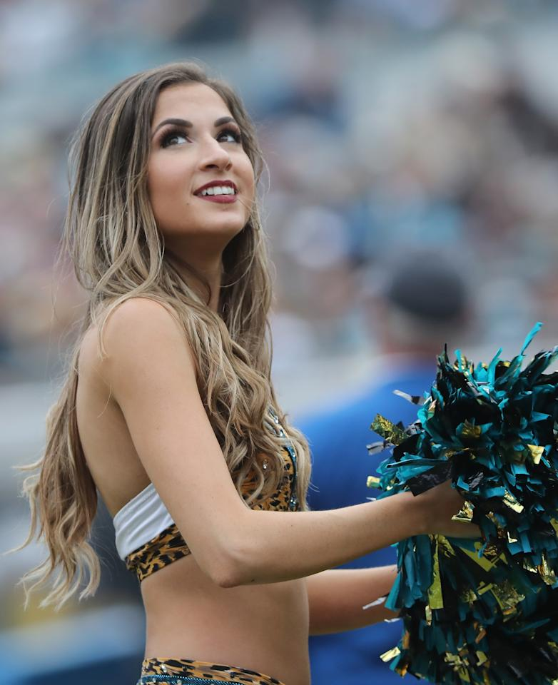 <p>A Jacksonville Jaguars cheerleader waits on the field in the second half of their game against the Indianapolis Colts at EverBank Field on December 3, 2017 in Jacksonville, Florida. (Photo by Sam Greenwood/Getty Images) </p>