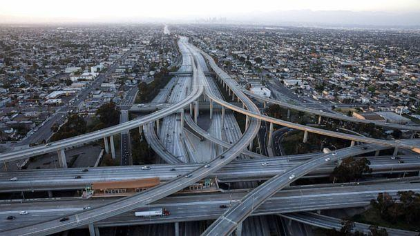PHOTO: Vehicles drive in light traffic on the Judge Harry Pregerson Interchange between the 105 and 110 freeways in this aerial photograph taken above Los Angeles, California, U.S., on Friday, May 1, 2020. (Patrick T. Fallon/Bloomberg via Getty Images)