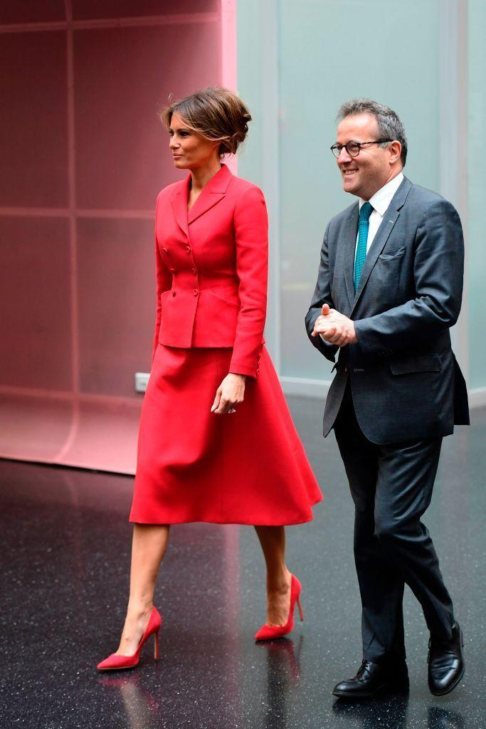 <p>In Paris with her husband for meetings with French president Emmanuel Macron, Melania Trump wears red Dior for a visit to Necker Hospital for children.</p>