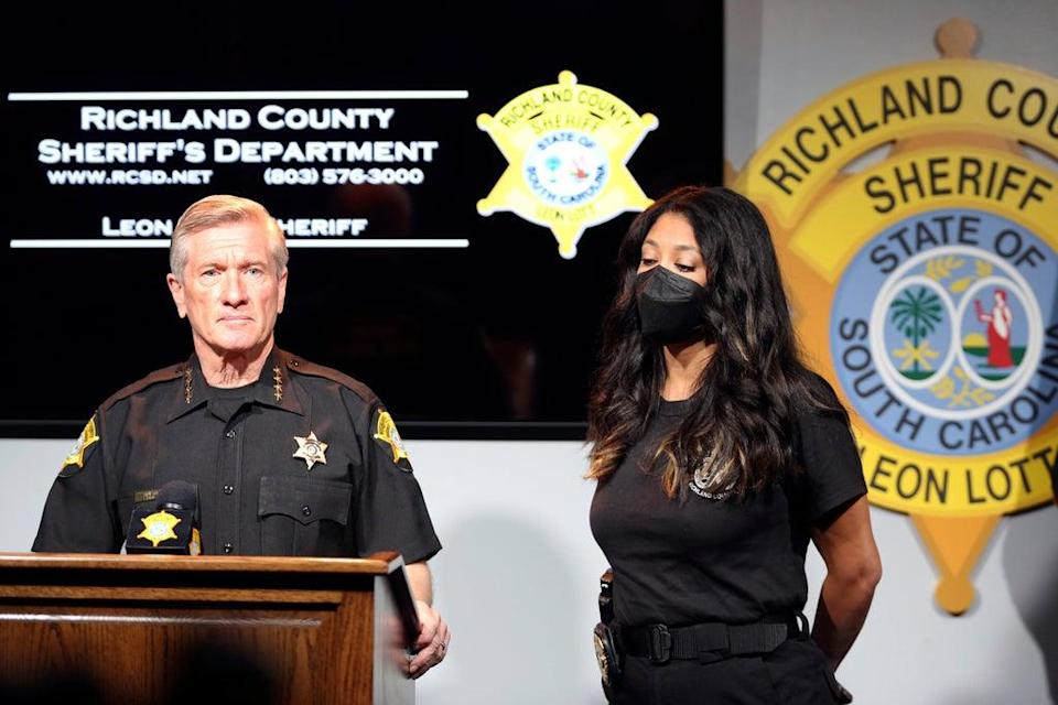 Richland County Sheriff Leon Lott, left, and Coroner Nadia Rutherford, right, talk about the heat deaths of two 20-month-old twin boys during a news conference on Tuesday 21 September 2021, in Columbia, South Carolina.  (AP)