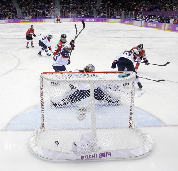 Marie-Philip Poulin of Canada (29) scores the game-winning goal against USA in overtime during the women's gold medal ice hockey game at the 2014 Winter Olympics, Thursday, Feb. 20, 2014, in Sochi, Russia. (AP Photo/David J. Phillip )