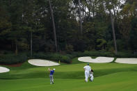 Collin Morikawa hits to the 13th green during the first round of the Masters golf tournament Friday, Nov. 13, 2020, in Augusta, Ga. (AP Photo/David J. Phillip)