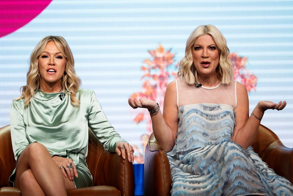 """Cast member Tori Spelling gestures next to Jennie Garth during a panel for the Fox television series """"BH90210"""" during the Summer TCA (Television Critics Association) Press Tour in Beverly Hills, California, U.S., August 7, 2019. REUTERS/Mario Anzuoni"""