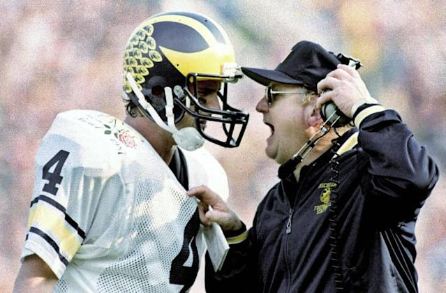 FILE - In this Jan. 2, 1987, file photo, Michigan head coach Bo Schembechler yells at quarterback Jim Harbaugh as the Wolverines fell victim to Arizona State 22-15 in the Rose Bowl NCAA college football game in Pasadena, Calif. The former Wolverines quarterback is returning to Ann Arbor, to coach his alma mater. The 51-year-old Harbaugh signed a seven-year deal to become the new coach at Michigan that will pay him $5 million per year. (AP Photo/Reed Saxon, File)