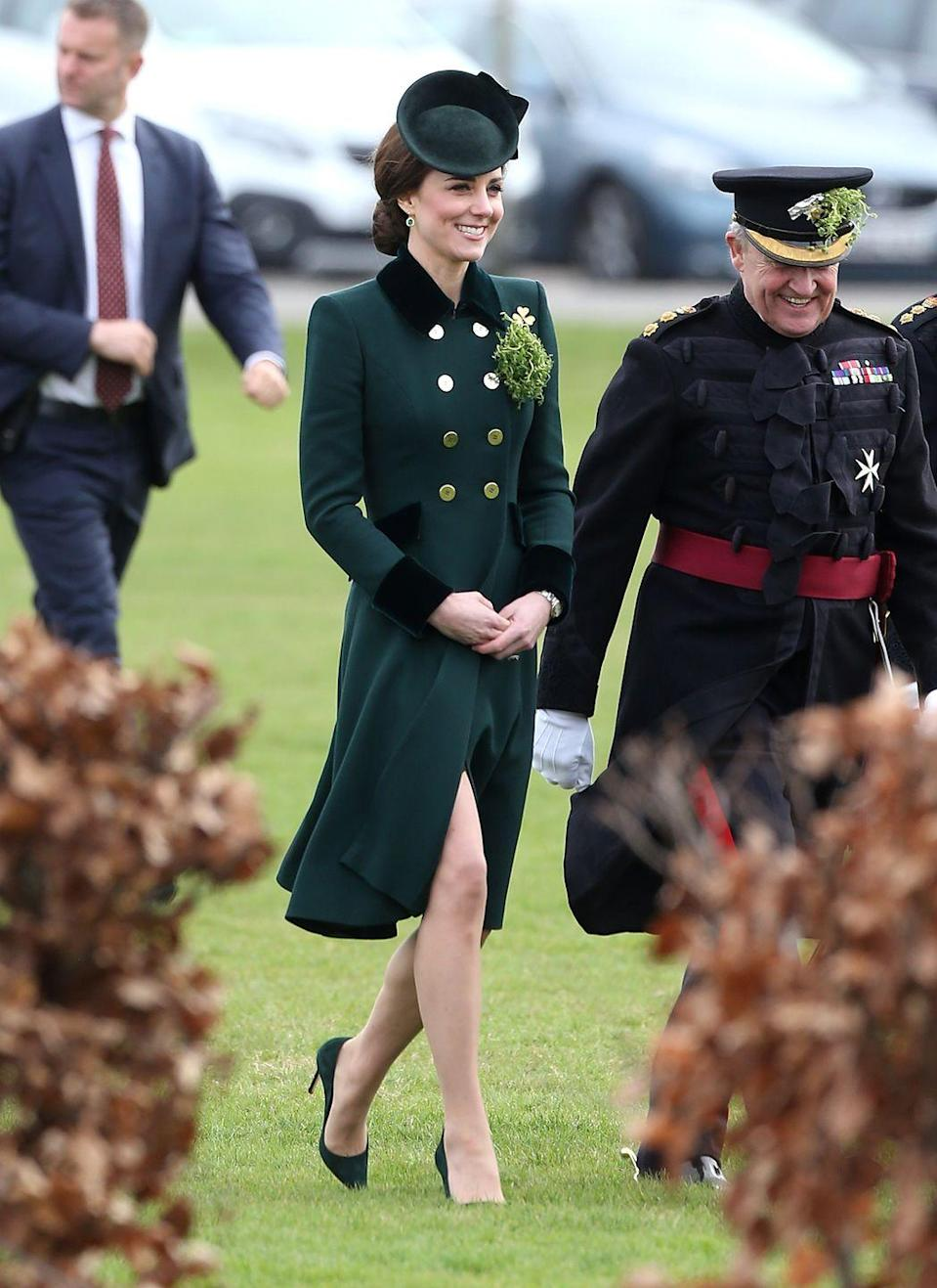 <p>Duchess Catherine dons a green coat from Catherine Walker at the annual St. Patrick's Day parade in London. She accessorized with an Irish Guards brooch to celebrate the day of good fortune.</p>