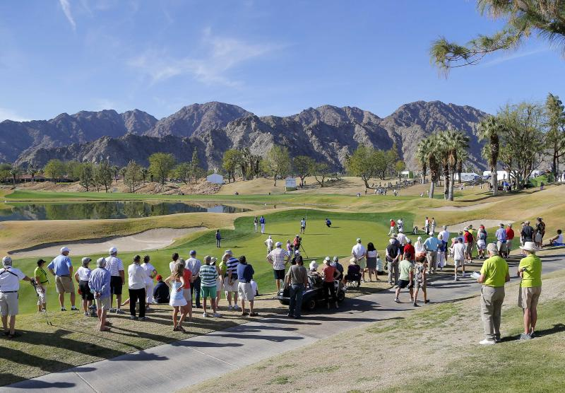 The gallery lines up to watch Patrick Reed on the ninth tee during the third round of the Humana Challenge PGA golf tournament on the Nicklaus Private course at PGA West, Saturday, Jan. 18, 2014, in La Quinta, Calif. Reed shot 9-under par for the third day in a row and is 27-under par going into the final round. (AP Photo/Matt York)
