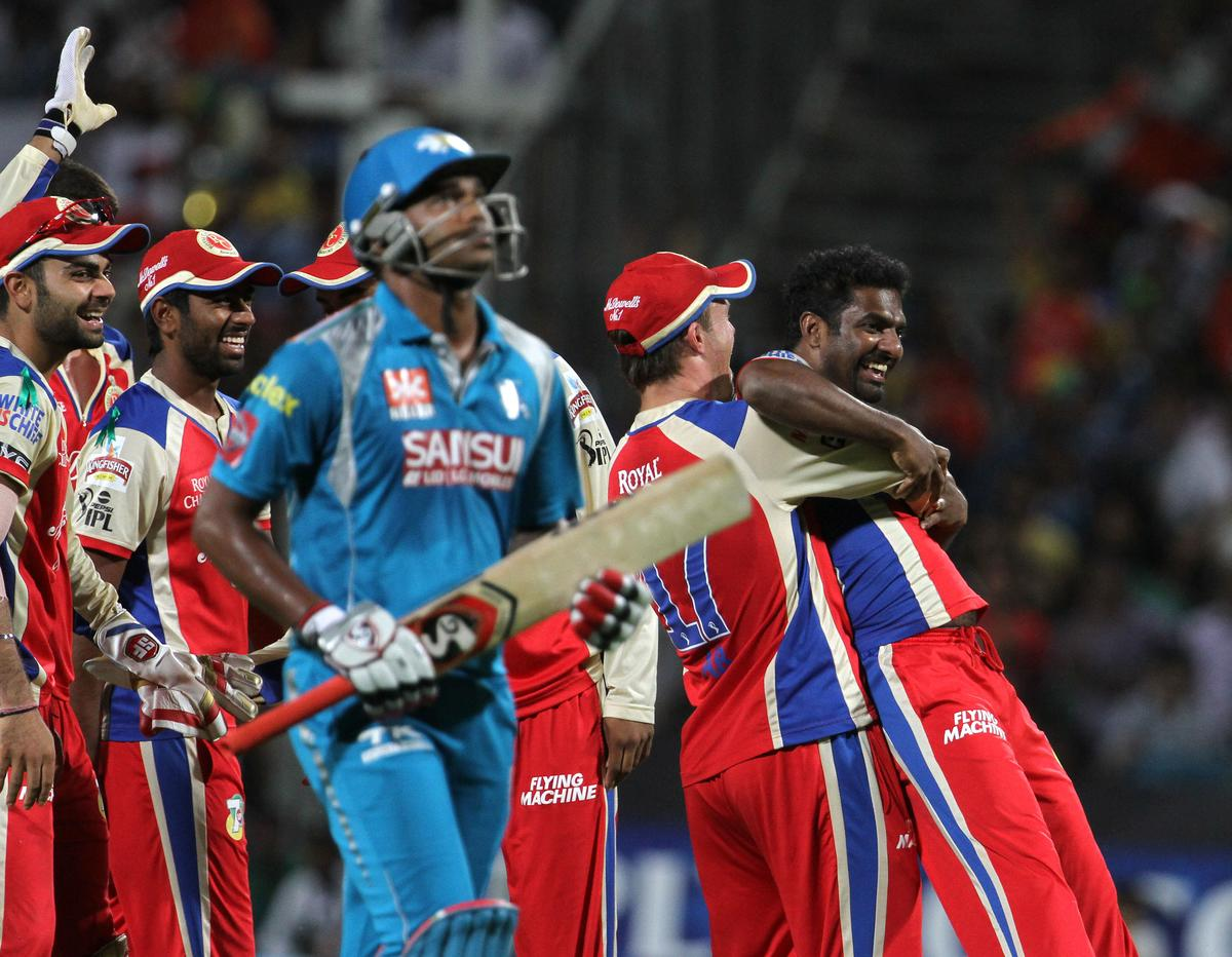 Royal Challengers Bangalore player Muttiah Muralitharan celebrates with his teammates after he ran out Pune Warriors player Tirumalasetti Suman during match 46 of the Pepsi Indian Premier League ( IPL) 2013  between The Pune Warriors India and the Royal Challengers Bangalore held at the Subrata Roy Sahara Stadium, Pune on the 2nd May 2013..Photo by Vipin Pawar-IPL-SPORTZPICS  ..Use of this image is subject to the terms and conditions as outlined by the BCCI. These terms can be found by following this link:..https://ec.yimg.com/ec?url=http%3a%2f%2fwww.sportzpics.co.za%2fimage%2fI0000SoRagM2cIEc&t=1506074880&sig=mwV_L_ygIKMAvdgTWPxKSg--~D