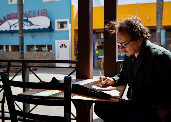 """Gustavo Arellano on assignment in Catalina in March. <span class=""""copyright"""">(Francine Orr / Los Angeles Times)</span>"""