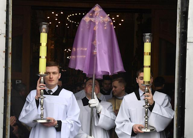 <p>Priests during a morning mass at St Francis Xavier Cathedral in Grodno, Belarus on Maundy Thursday, March 29, 2018. Priests renew their vows during the mass. (Photo: Viktor Drachev\TASS via Getty Images) </p>