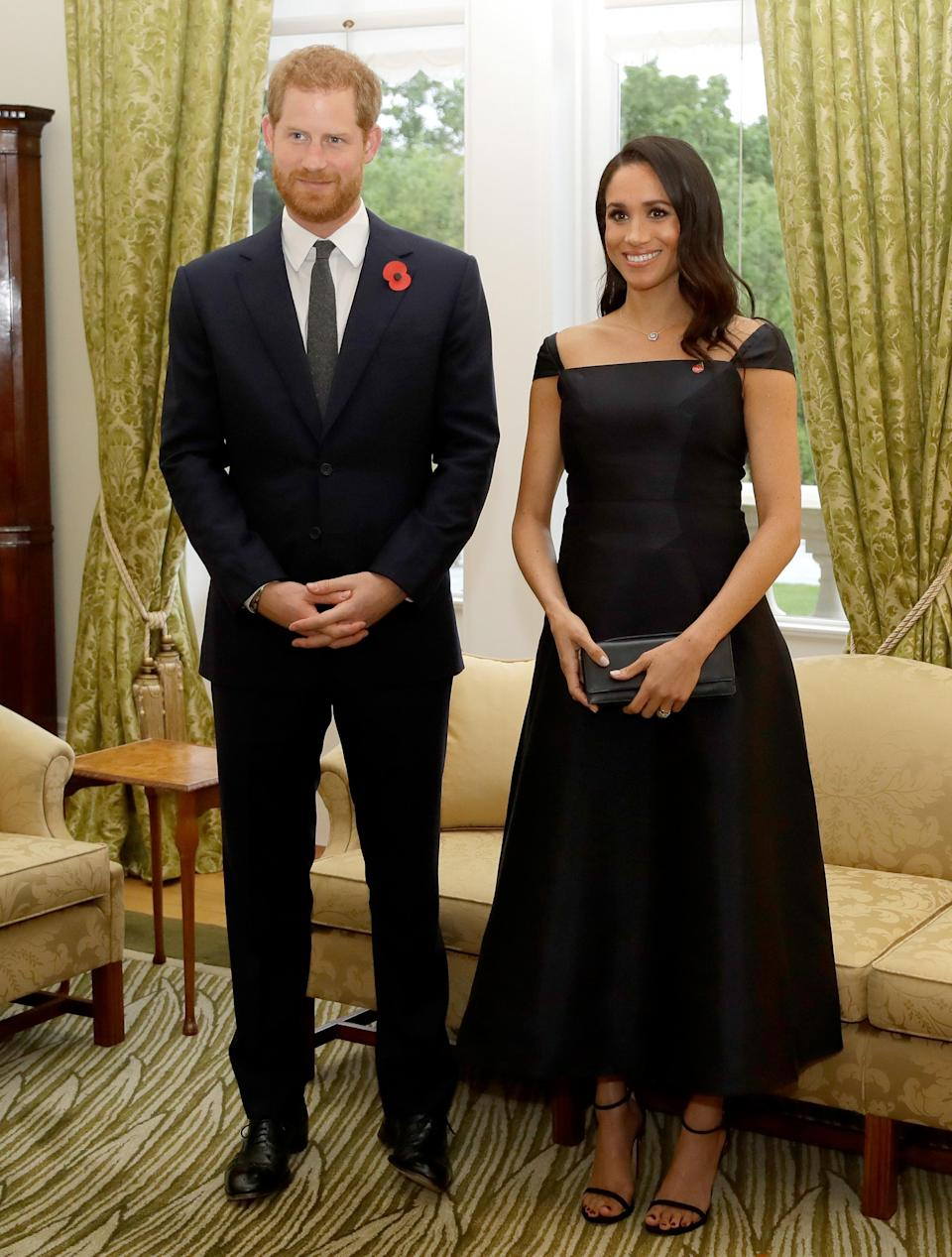 <p>At Government House in Wellington, New Zealand, the Duchess looked elegant in a £1,963 Gabriela Hearst 'Herve' dress with her Dior clutch bag [Photo: Getty] </p>