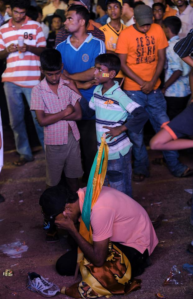 A dejected Sri Lankan cricket fan cries during a telecast of the Cricket World Cup final match between Sri Lanka and India, in Colombo on April 2, 2011. India defeated Sri Lanka by six wickets to win the 2011 World Cup.  AFP PHOTO / Lakruwan WANNIARACHCHI (Photo credit should read LAKRUWAN WANNIARACHCHI/AFP/Getty Images)