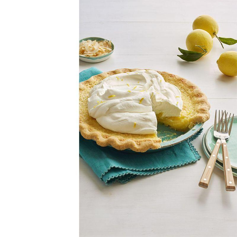 """<p>End your holiday on a sweet note with this fresh lemon pie topped with coconut whipped cream.</p><p><a href=""""https://www.womansday.com/food-recipes/food-drinks/recipes/a58526/lemon-coconut-chess-pie-recipe/"""" rel=""""nofollow noopener"""" target=""""_blank"""" data-ylk=""""slk:Get the Lemon Coconut Chess Pie recipe."""" class=""""link rapid-noclick-resp""""><em>Get the Lemon Coconut Chess Pie recipe.</em></a></p>"""