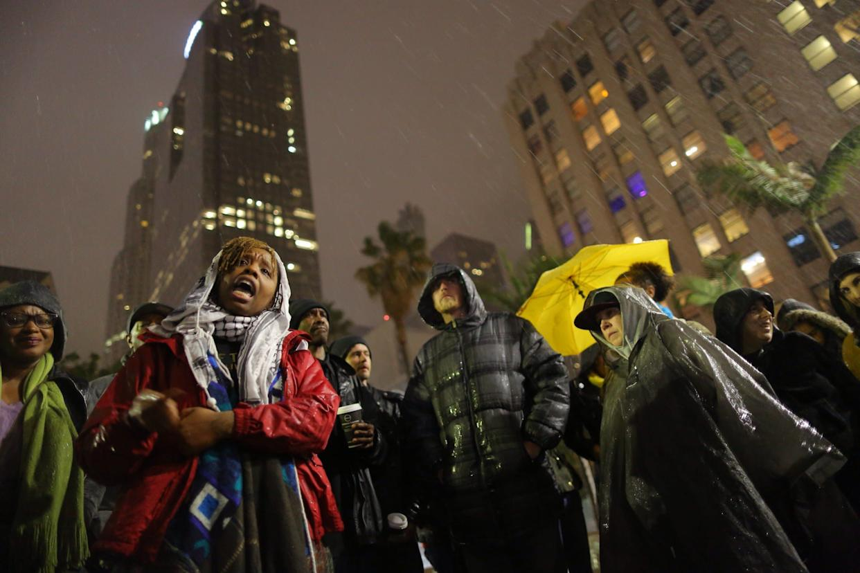 The author, Patrisse Cullors, speaks to people gathered to protest the Los Angeles Police shooting of a homeless man on March 1, 2015 in Los Angeles, California. (Photo: Marcus Yam via Getty Images)