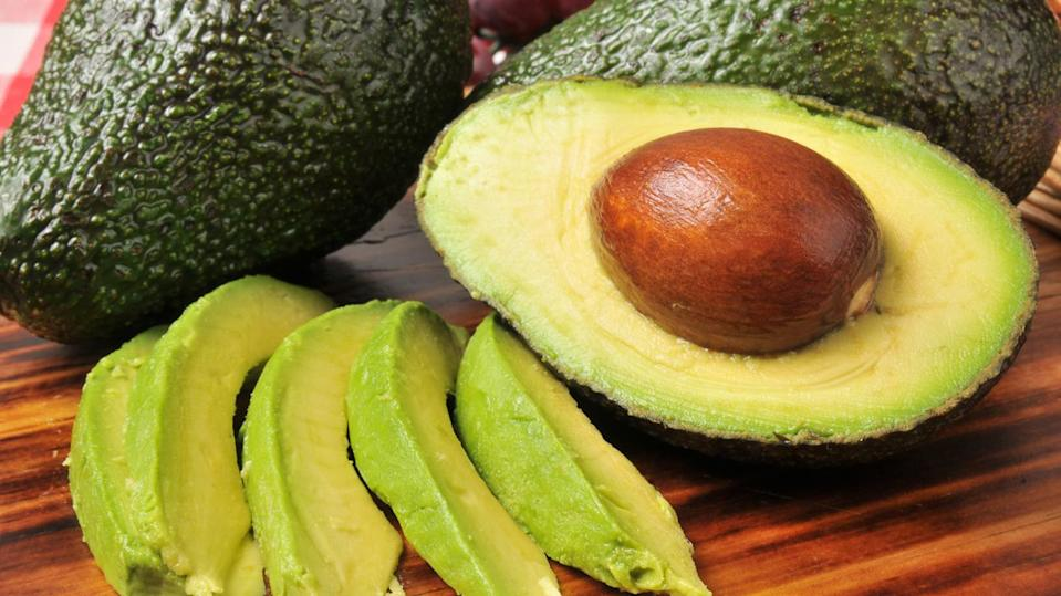 Cut and whole avocados