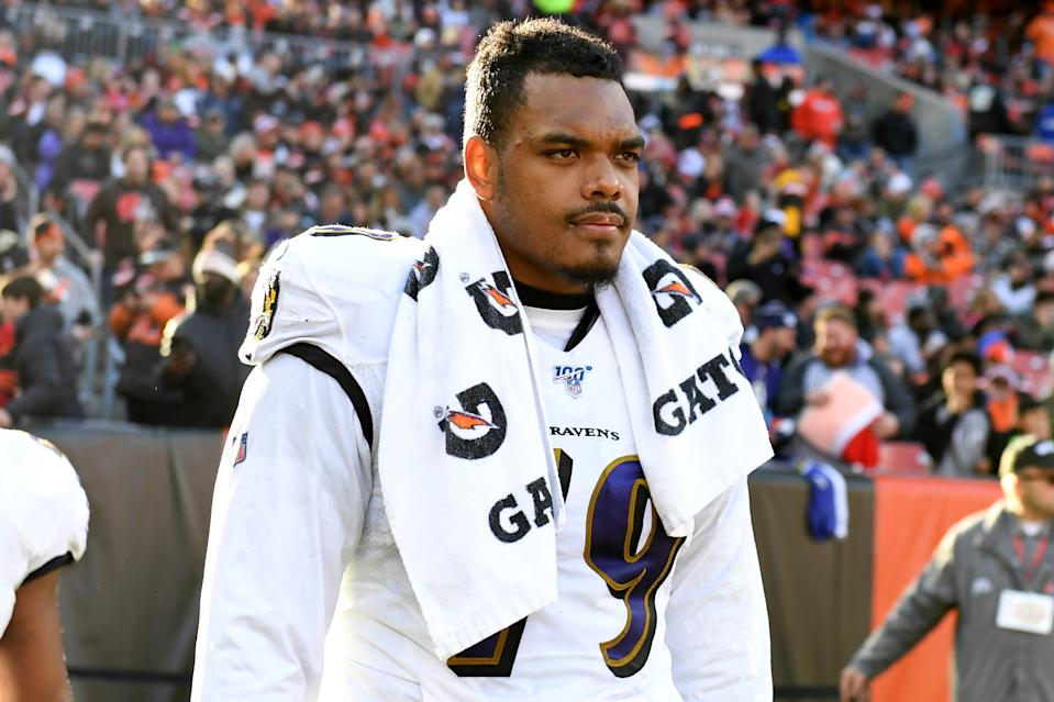 Ronnie Stanley with towel around his white jersey.