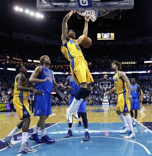 New Orleans Hornets forward Anthony Davis (23) dunks in front of Dallas Mavericks forward Dirk Nowitzki (41), of Germany, in the first half of an NBA basketball game in New Orleans, Friday, Feb. 22, 2013. (AP Photo/Gerald Herbert)