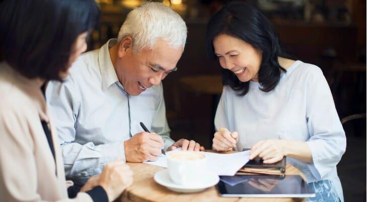 Senior man signs a power of attorney form